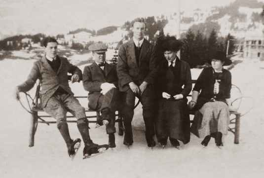 group of people wearing ice skates